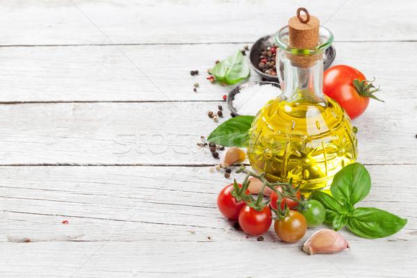 помидоров базилик оливкового масла специи деревянный стол приготовления Сток-фото © karandaev