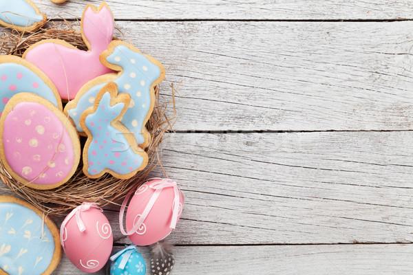 Húsvét mézeskalács sütik tojások fa asztal nyulak Stock fotó © karandaev