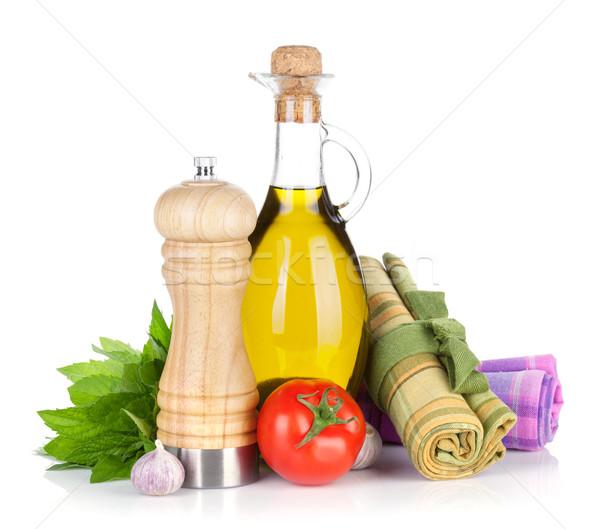 Fresh herbs, tomato, olive oil and pepper shaker Stock photo © karandaev