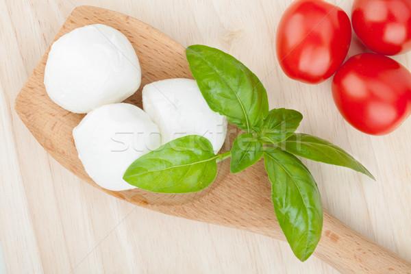 Mozzarella domates fesleğen ahşap masa tablo yeşil Stok fotoğraf © karandaev