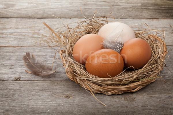 Uova nido tavolo in legno legno sfondo uccello Foto d'archivio © karandaev