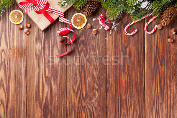 Christmas gift box, food decor and tree branch Stock photo © karandaev