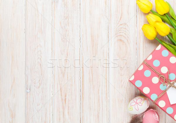 Húsvét színes tojások citromsárga tulipánok fehér Stock fotó © karandaev