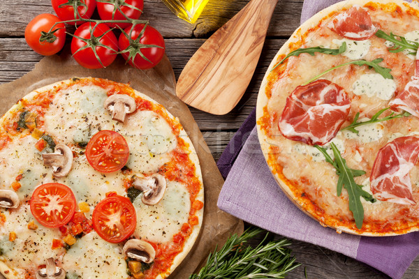 Pizza with prosciutto and mozzarella and with tomatoes and mushr Stock photo © karandaev
