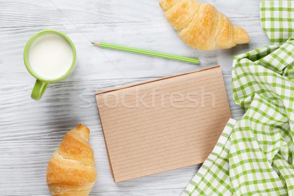 свежие круассаны молоко блокнот деревянный стол Top Сток-фото © karandaev