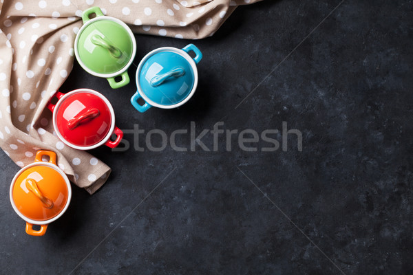 Colorful saucepans on stone Stock photo © karandaev
