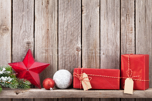Christmas gift boxes and decor in front of wooden wall Stock photo © karandaev