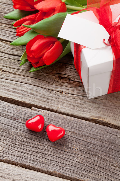Red tulips and Valentine's day candy hearts Stock photo © karandaev