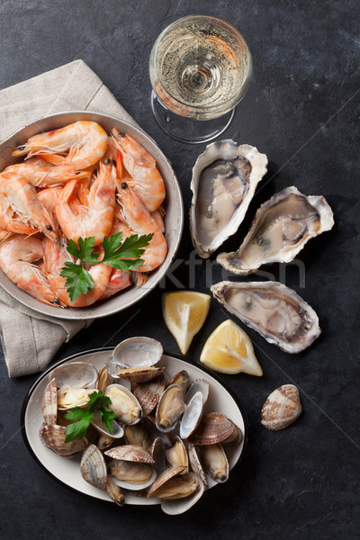 Fraîches fruits de mer vin blanc pierre table haut Photo stock © karandaev