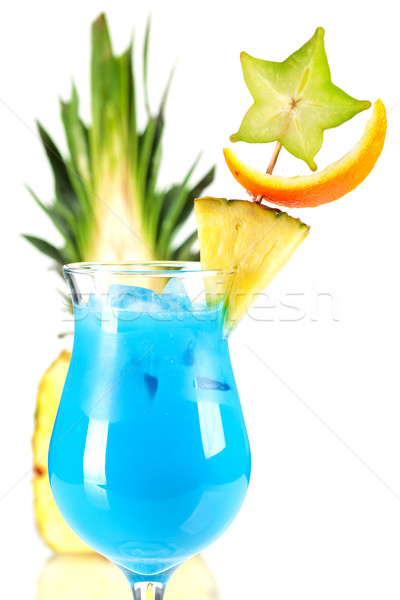 Blue Hawaii tropical cocktail with pineapple on background Stock photo © karandaev