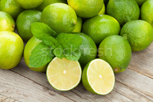 Fresh ripe limes with mint Stock photo © karandaev