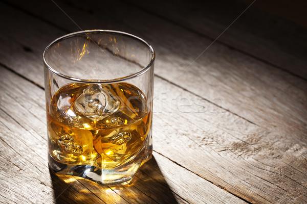 Glass of whiskey with ice Stock photo © karandaev