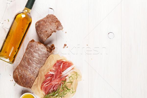 Prosciutto botella de vino mesa de madera superior vista espacio de la copia Foto stock © karandaev