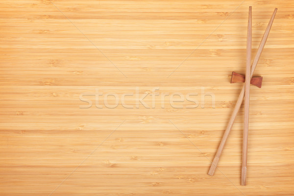 Sushi chopsticks on bamboo table Stock photo © karandaev
