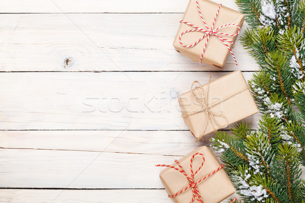 Christmas fir tree with snow and gift boxes Stock photo © karandaev