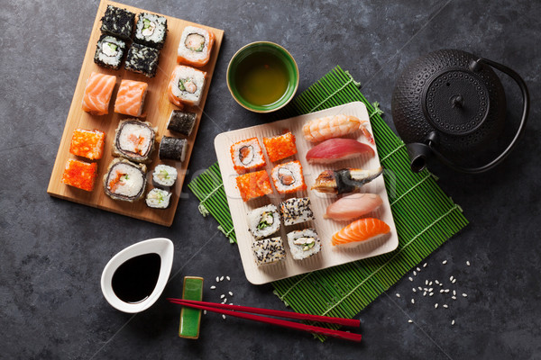 Set of sushi, maki and green tea Stock photo © karandaev