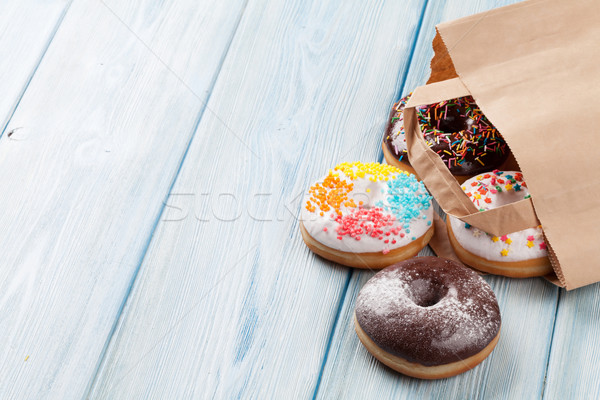 Colorful donuts in paper bag Stock photo © karandaev