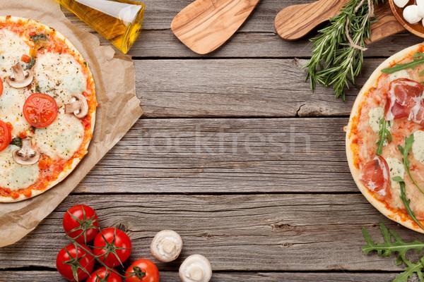 Pizza prosciutto paradicsomok gombák mozzarella fa asztal Stock fotó © karandaev