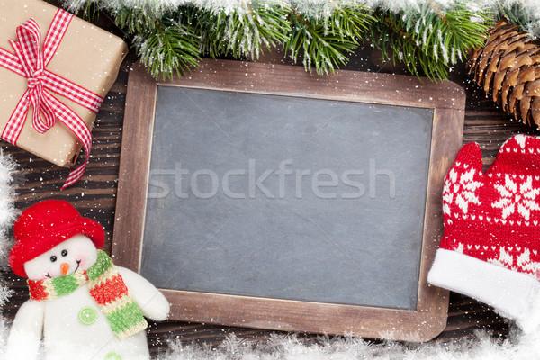 Navidad pizarra muñeco de nieve caja de regalo mitones Foto stock © karandaev