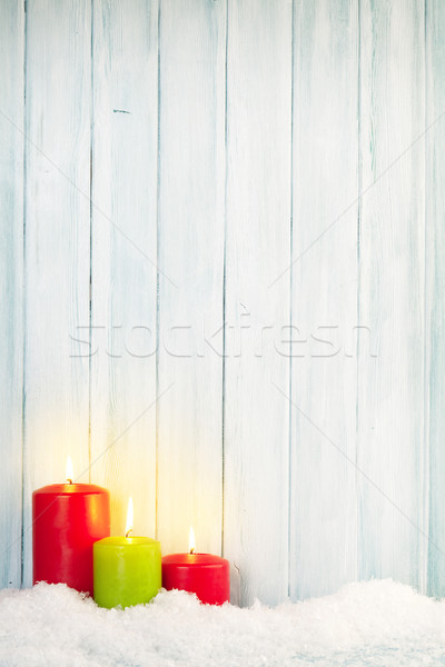 Christmas background with candles in snow Stock photo © karandaev
