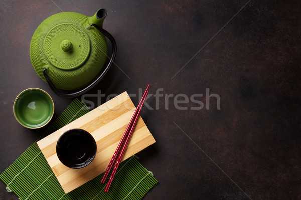 Green teapot and tea cups Stock photo © karandaev