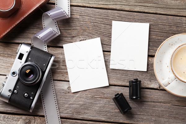 Vintage camera and blank photo frames Stock photo © karandaev