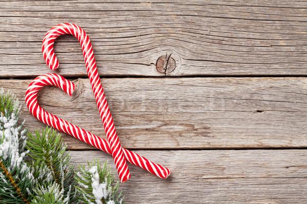 Weihnachten candy Zuckerrohr Schnee Holztisch Stock foto © karandaev