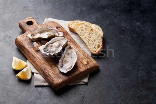 Oysters and lemon Stock photo © karandaev