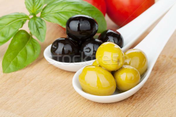 Olives, tomatoes and basil Stock photo © karandaev