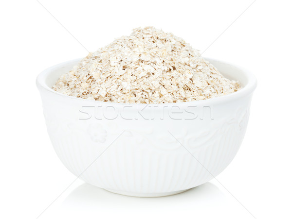 Oat flakes in bowl Stock photo © karandaev