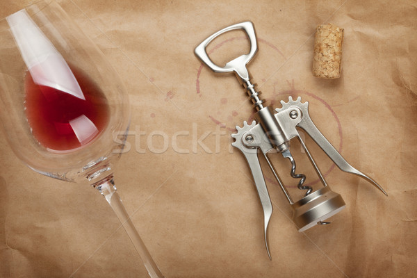 Stock photo: Wine glass, cork and corkscrew with red wine stains