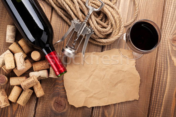 Red wine, corks, corkscrew and piece of paper Stock photo © karandaev