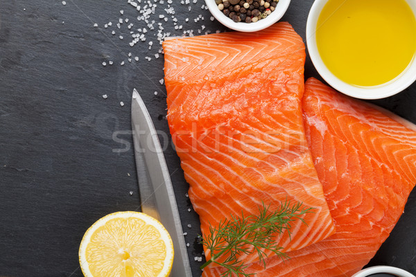 Salmon and spices on stone table Stock photo © karandaev