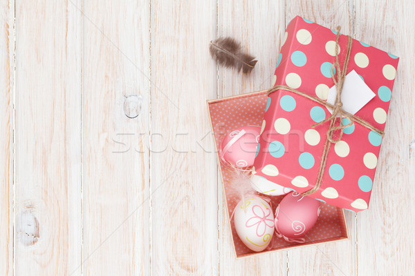 Easter eggs in gift box Stock photo © karandaev