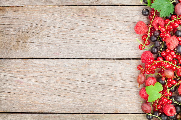 Stock photo: Fresh ripe berries on wooden table