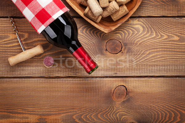 Red wine bottle, corks and corkscrew Stock photo © karandaev