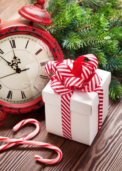 Navidad despertador caja de regalo rama mesa de madera Foto stock © karandaev