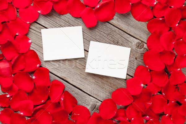 Photo frames over wood and red rose petals Stock photo © karandaev