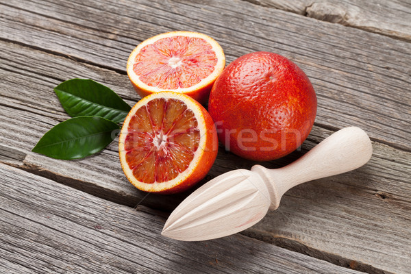Fresh ripe red oranges and juicer Stock photo © karandaev