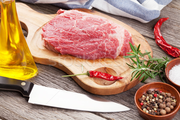 Raw beef steak with spices and herbs Stock photo © karandaev