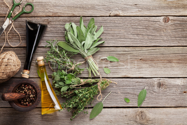 Friss kert gyógynövények fűszerek fa asztal oregano Stock fotó © karandaev