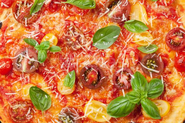 Pizza with tomatoes, mozzarella and basil Stock photo © karandaev