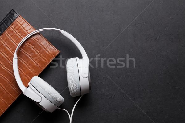 Headphones and notepad Stock photo © karandaev