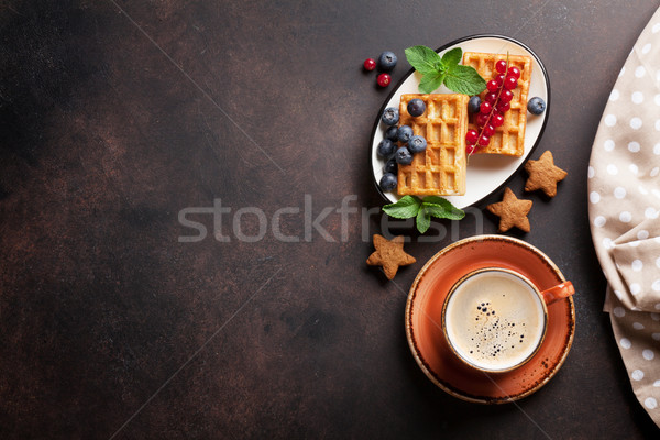 Coffee, sweets and waffles with berries Stock photo © karandaev
