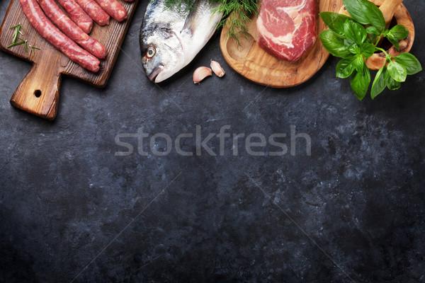 Salsicce pesce carne cottura ingredienti top Foto d'archivio © karandaev