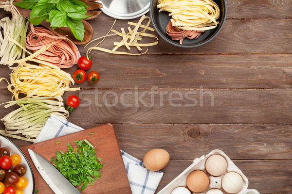Pasta cooking ingredients and utensils on wooden table Stock photo © karandaev