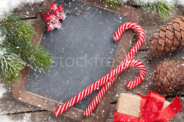 Christmas gift box, candy canes and fir tree Stock photo © karandaev