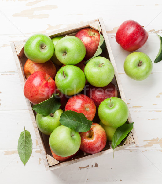 Stock photo: Green and red apples in wooden box