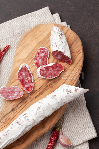 Sliced salami on cutting board Stock photo © karandaev
