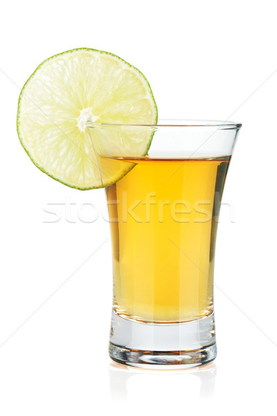 Shot of gold tequila with lime slice Stock photo © karandaev